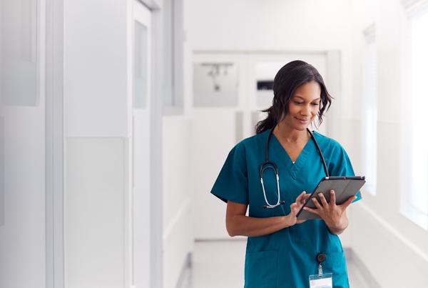 Medical professional using an iPad.