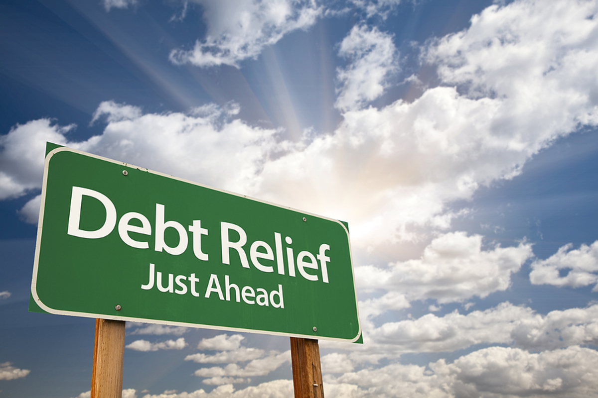 Debt relief just ahead road sign.