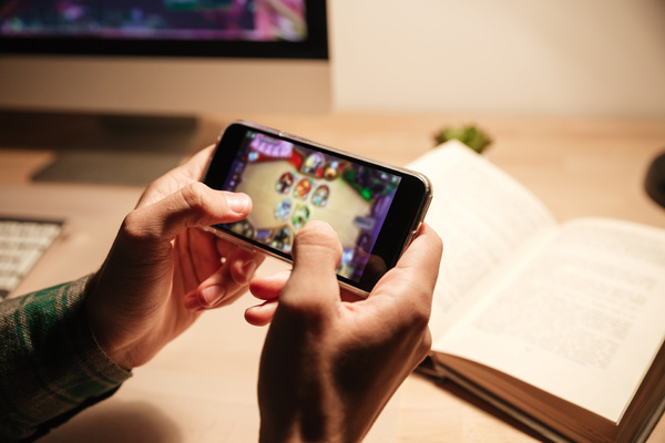 Playing a game on a mobile phone.
