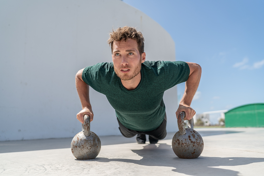 Working out with kettle bells.
