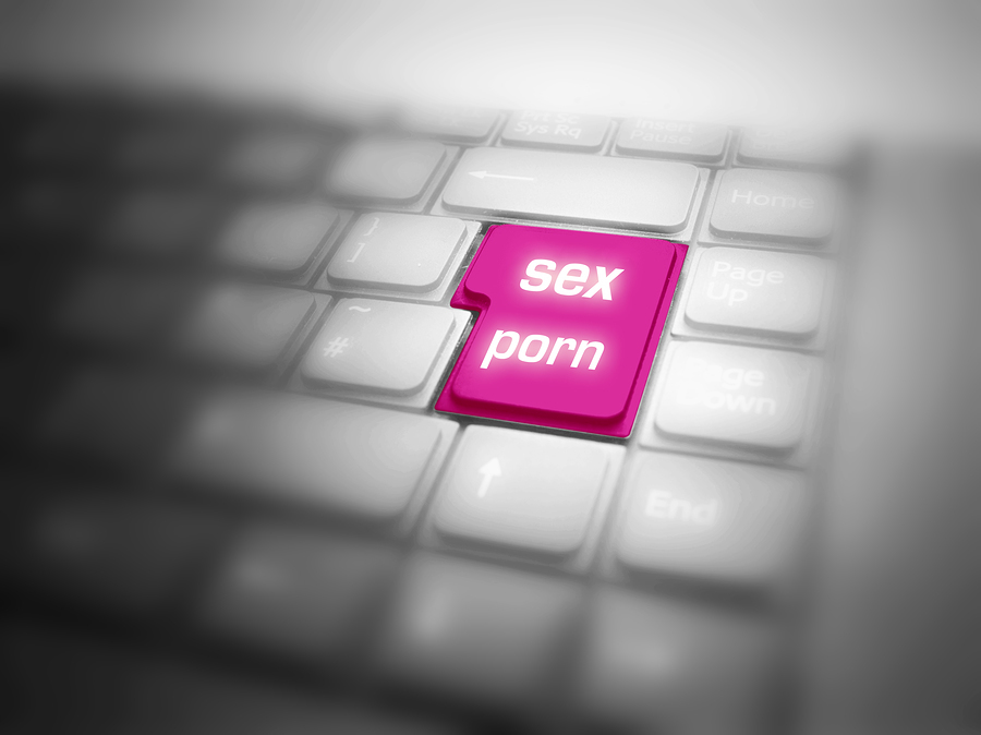 Computer keyboard key labeled sex porn.