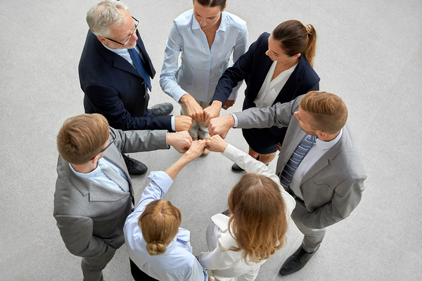 Group of colleagues forming a circle.