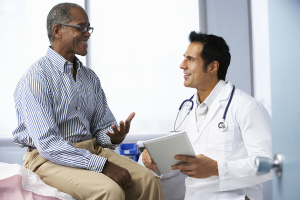 Medical doctor consulting with a male patient.