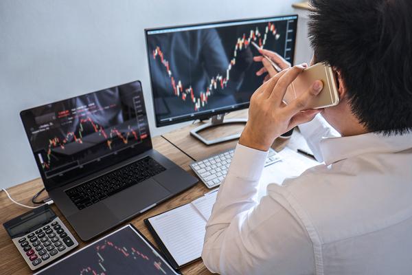 Looking at graphs on a computer monitor.