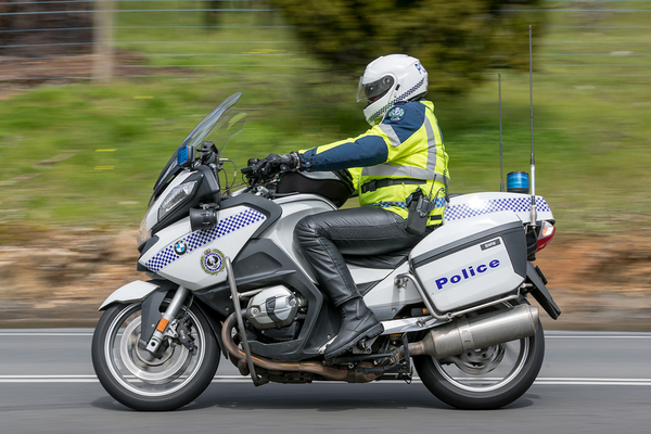 Police officer on a motorcycle.