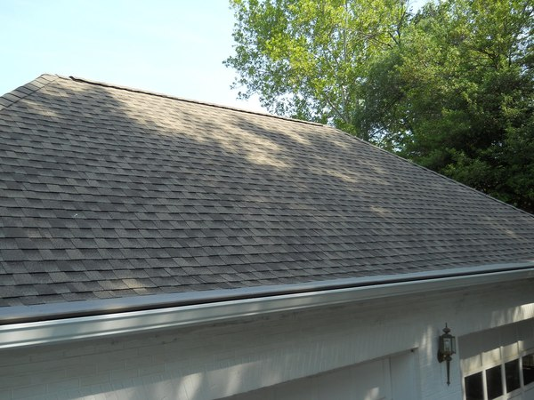 Shingled roof over a garage.