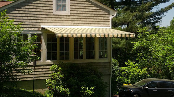 House with a yellow and green awning attached.