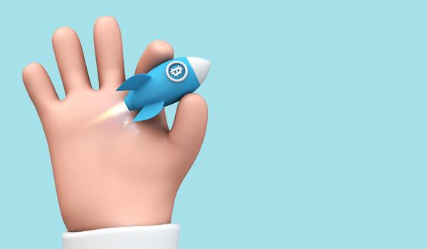 Hand held rocket with bitcoin symbol.