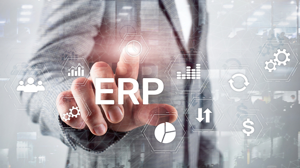Man pointing to the letters ERP.
