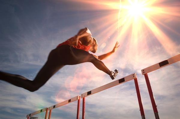 Man jumping over a hurdle.