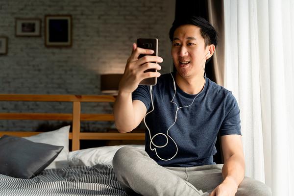 Man looking at his phone screen.