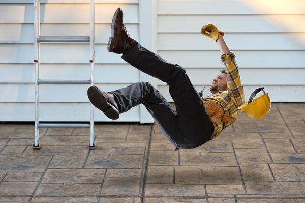 Construction worker falling off a ladder.
