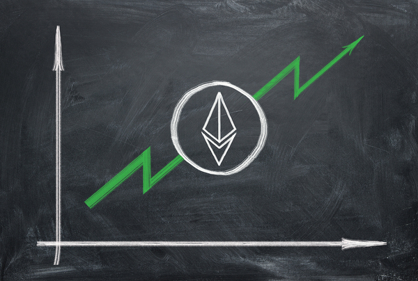 Chalkboard showing a green increasing line and a ethereum symbol.