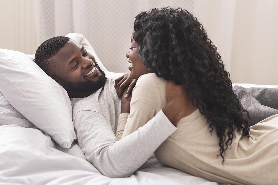 Smiling couple cuddling.