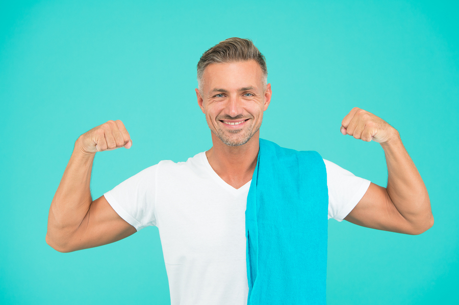 Man raising his arms to show fitness.