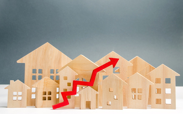 Multiple models of homes with an upward arrow.