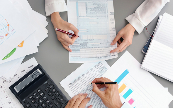 Person filling out their tax information.
