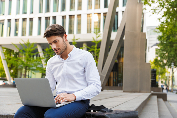 Outdoor businessman with a laptop