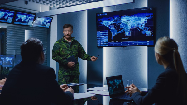Military person presenting information.