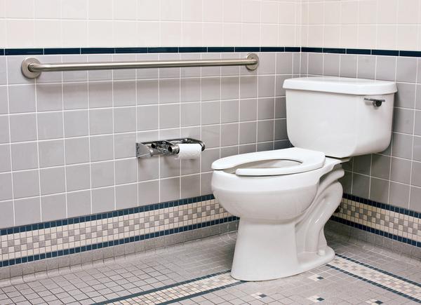 Bathroom with white toilet.