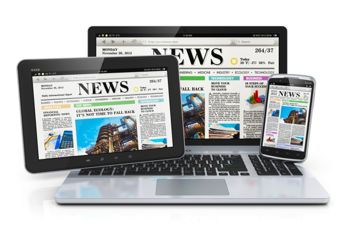 Tablet, laptop and smartphone displaying the same newspaper image.