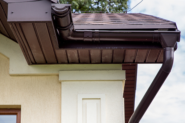 Brown roof with brown gutters.