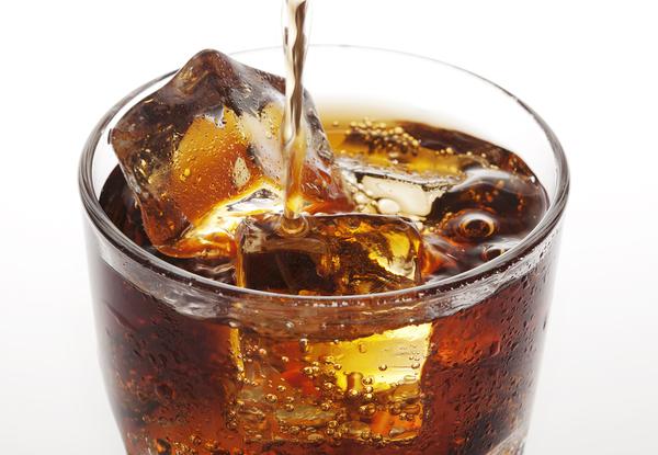 Coca-cola in a clear glass cup.