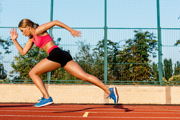 Runner sprinting on a track.