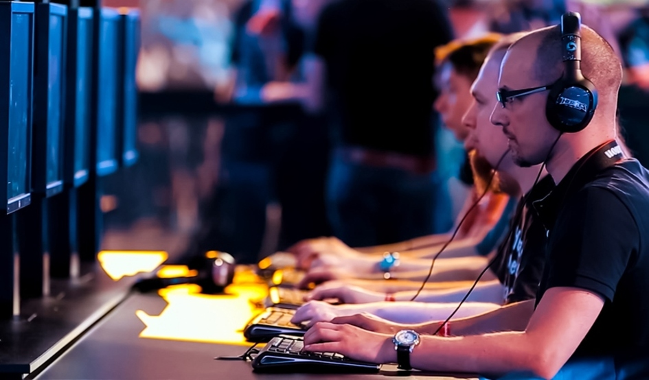 """Group of """"gamers"""" playing games on desktop computers."""