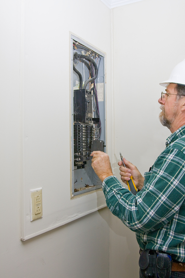 Man working on an electrical panel.