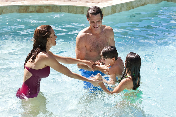 Family having fun in a pool.