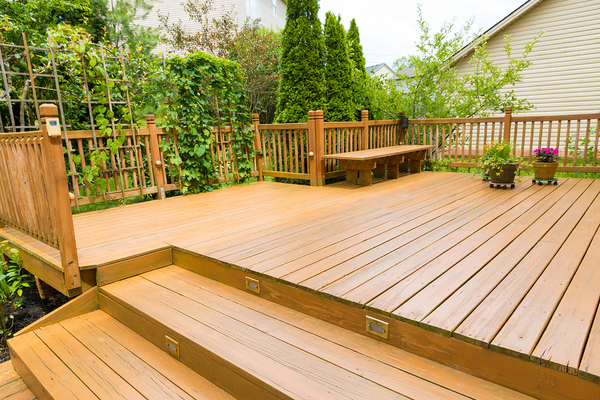 Outside deck with green bushes.