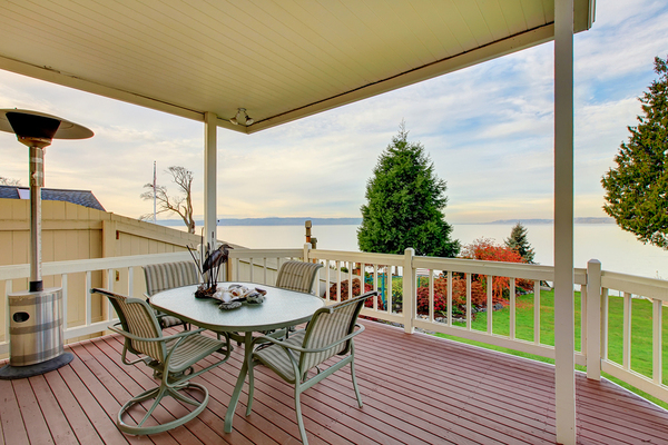 Outside deck with awning and dining table.