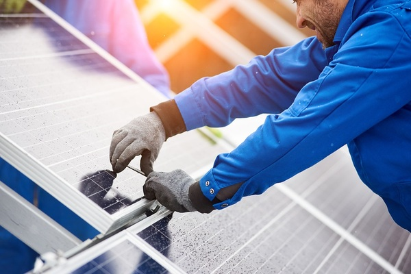 Person working on solar panels.