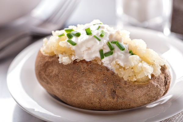Baked potato with sour cream and chives.