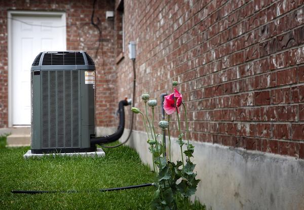 AC unit outside a brick building.