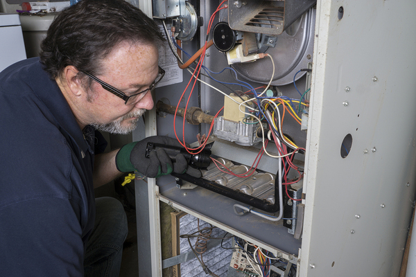 Man repairing a heater unit.