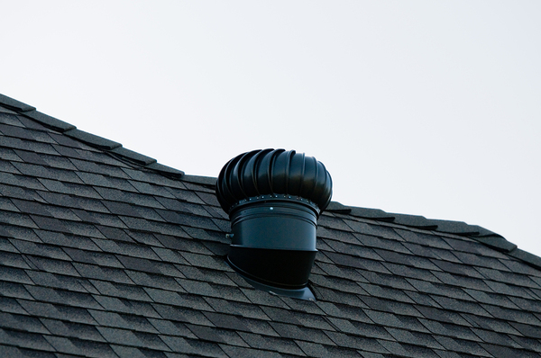 Roof top with shingles and a vent.
