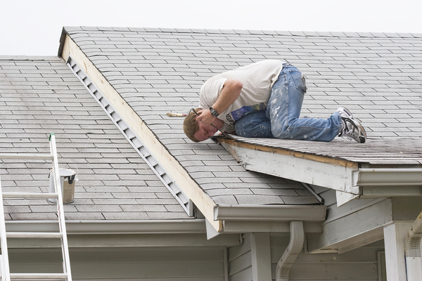 Person working on a roof.
