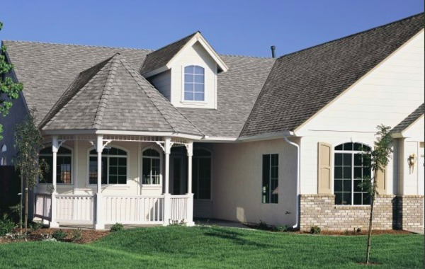 White home with a shingled roof and white gutters.