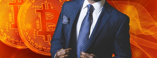 Man in a business suit with bitcoin symbols in the background