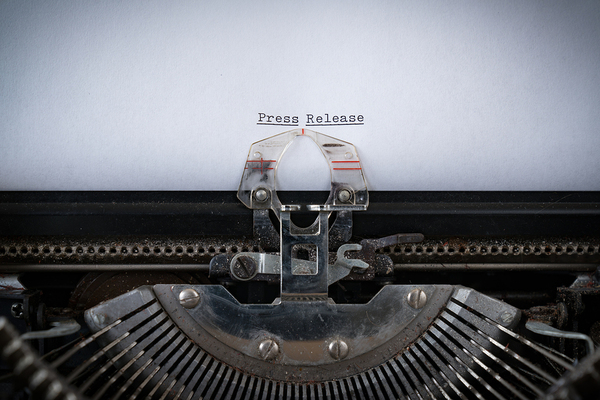 Old fashioned typewriter with the words press release displayed
