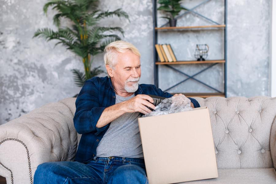 Man opening a box.