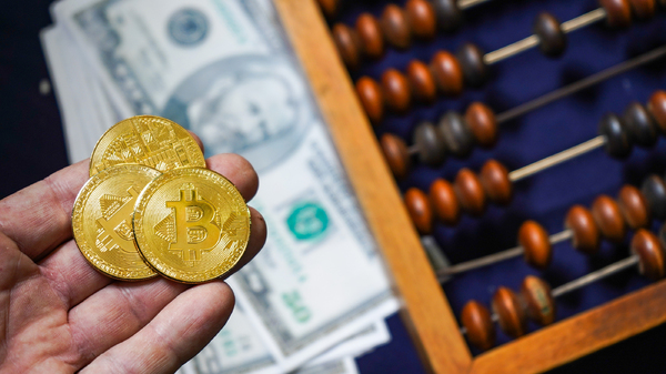 Three gold coins with bitcoin symbols.