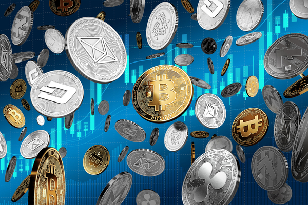 Silver and gold coins labeled with bitcoin symbol and cryptocurrency logos.