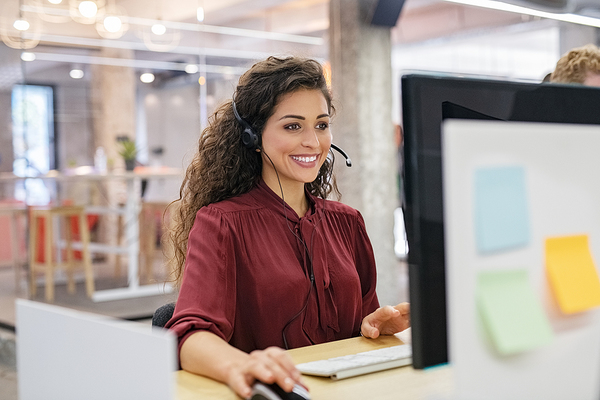 Smiling woman sitting at her desk.