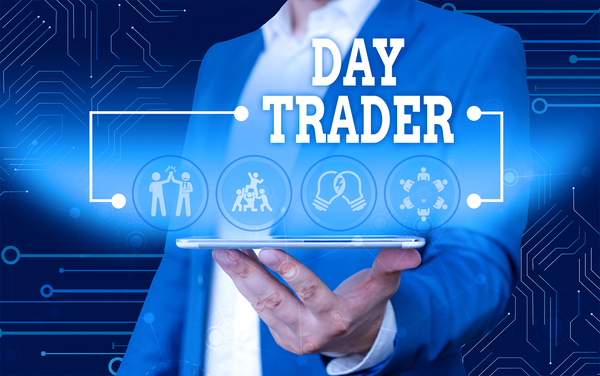 Man in a business suit holding a tablet displaying Day Trader.