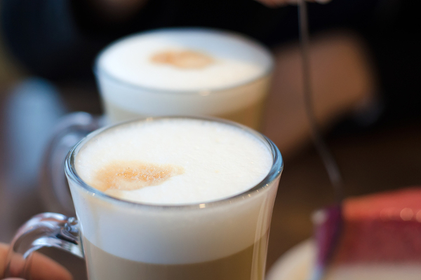 Cold whipped latte drinks in glass mugs.
