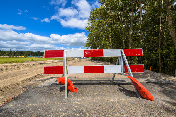 Road with a red and white roadblock.