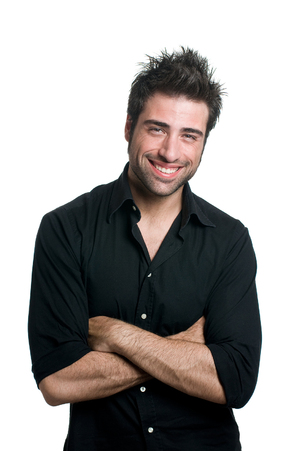 Man smiling with his arms crossed wearing a black shirt.